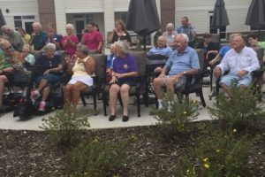 StoryPoint residents outside on patio