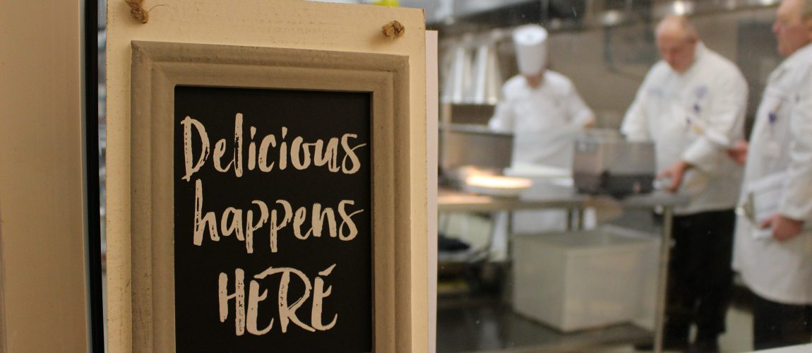 delicious happens here sign