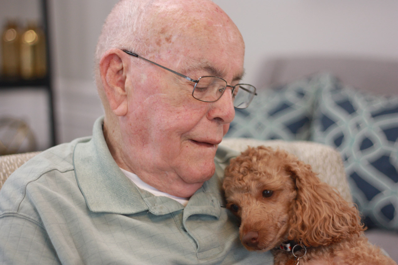 StoryPoint Resident and his dog