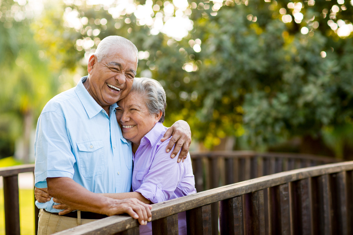 A senior couple laughing together on bridge