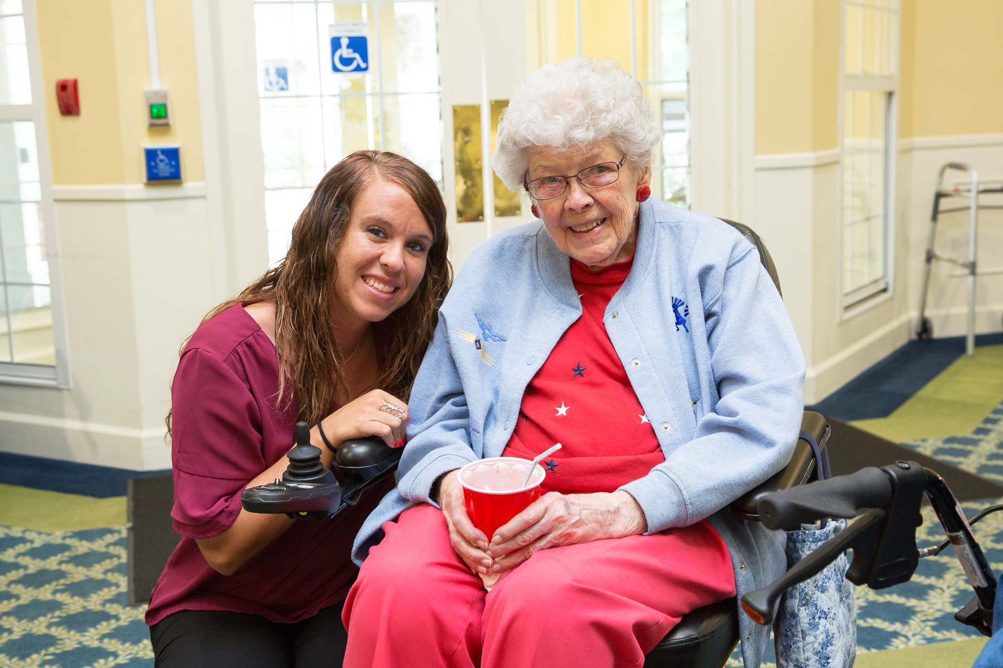 living center care staff with resident