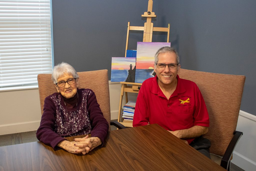Mother and son spending time together within the StoryPoint Senior Living Community in order to help make the transition to senior living more comfortable