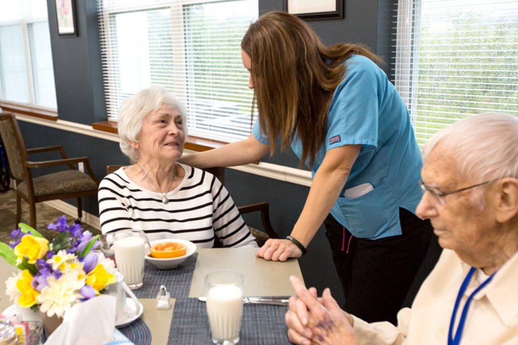 Staff member with senior living residents