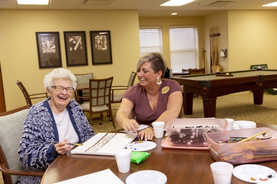 StoryPoint caregiver painting with resident